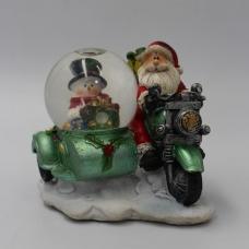 Санта на мопеде с шаром